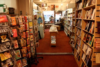 Rows of bookshelves inside Gay's The Word bookshop