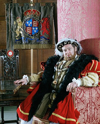 An actor playing Henry VIII at Eltham Palace