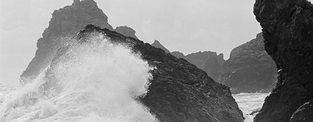 Waves crashing over rocky outcrops