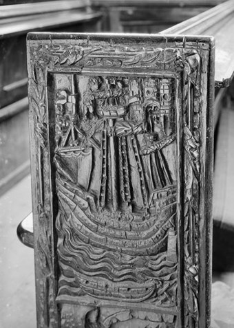 A medieval bench end from All Saints, East Budleigh, Devon, depicting a 16th-century armed vessel