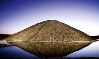 Silbury at night with a water-filled ditch