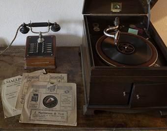A gramophone and a telephone handset