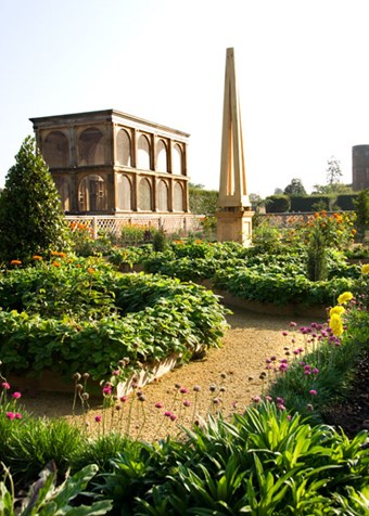 The aviary and one of the obelisks in the re-created garden as it appeared in 2008