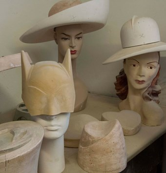 Boon & Lane carve plaster versions for the hat shapes they wish to create