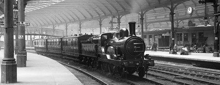 Archive photograph of a steam train in Newcastle Central Station 1894