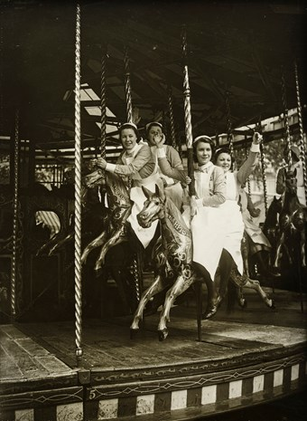 Nurses waving from a merry-go-round