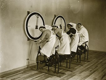 Nurses on stationary cycles in the gym