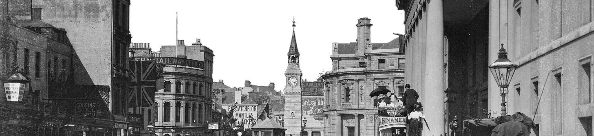 Black and white archive photograph of a busy street scene.