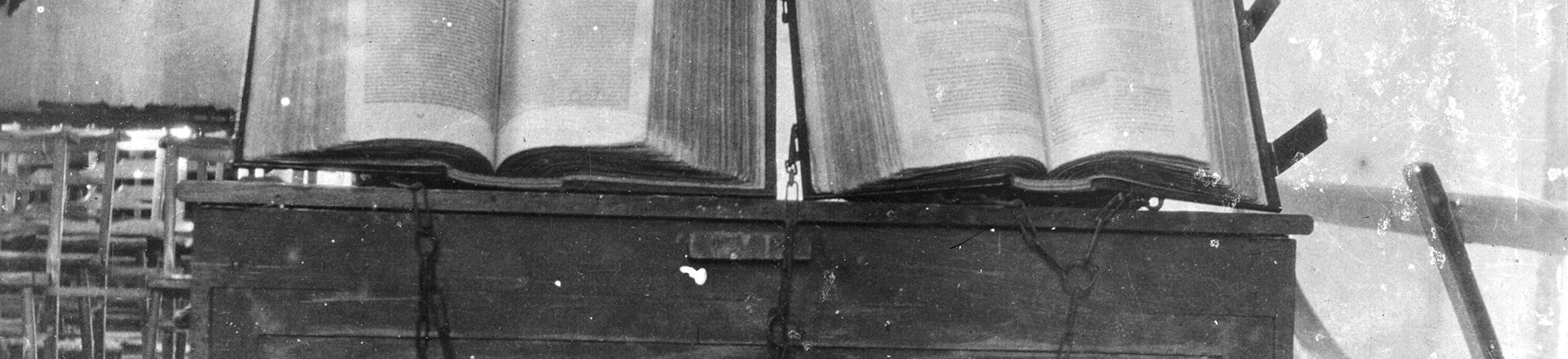Two books chained to a desk inside St Michael's Church Blewbury, in 1909.
