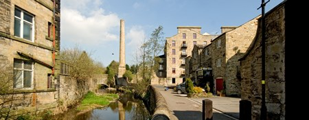 View along waterway to mill chimney and conversion, Skipton.