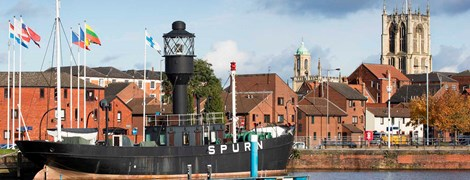 General view of the Spurn Lightship with Holy Trinity beyond