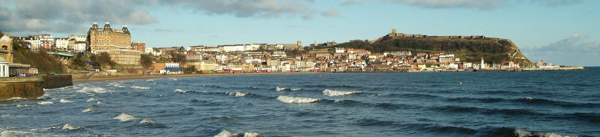 View across the water to the beach and the Grand Hotel, Scarborough, North Yorkshire