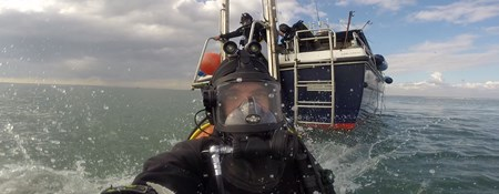 Diver Mark Beattie-Edwards at the surface before diving a wreck.