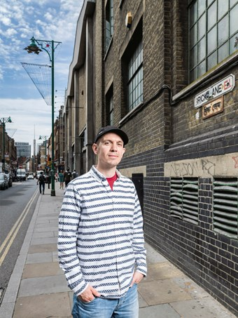 Martyn Hayes standing with hands in pockets on Brick Lane, London.