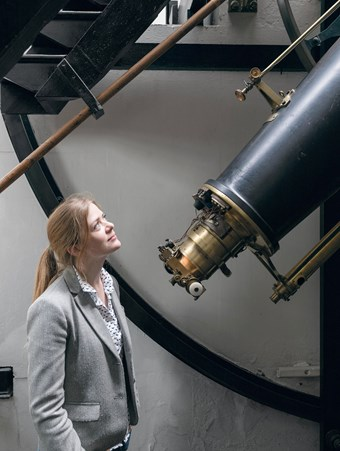 Anna Rolls looking up at the Airy Transit Circle telescope at the Royal Observatory.