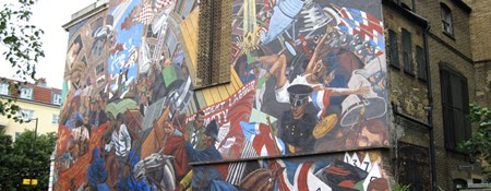 Mural on the side of a building commemorating the Battle of Cable Street