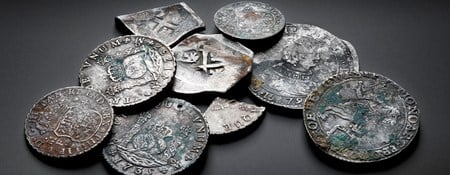 Collection of the different coins that were found in the wreck of the Rooswijk