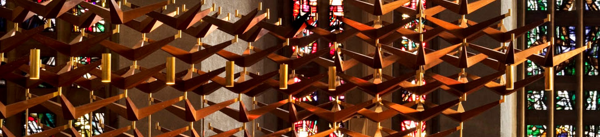 Detail of choir stalls and stained glass in Coventry Cathedral Church of St Michael