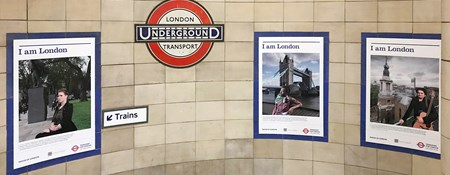 Three portraits from Historic England's I am London series displayed at Algate East Underground Station