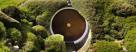 Image of the entrance to Underhill in Holme, West Yorkshire. Designed by Arthur Quarmby, Underhill is Britain's first modern earth-sheltered house and has been described as a luxury hobbit's home because of its captivating design.