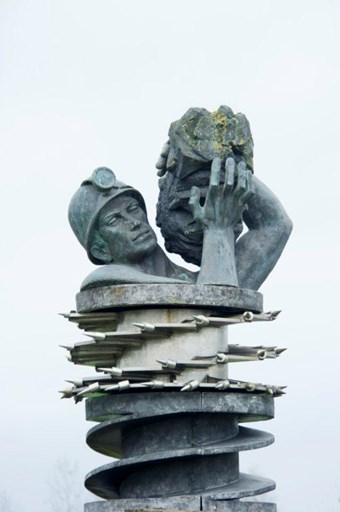 The Miner by Arthur Fleischmann, St Helens, 1964. Listed Grade II © Historic England