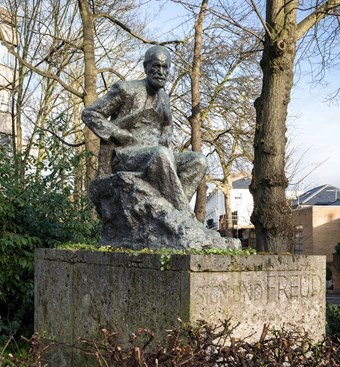 Sigmund Freud Statue by Oscar Nemon, 1970. Grounds of the Tavistock Clinic, at the junction of Belsize Lane & Fitzjohn's Avenue, Swiss Cottage, Hampstead, London. Listed Grade II © Historic England