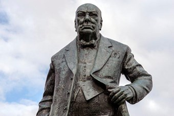 Winston Churchill Statue by David McFall, 1958-9, Junction of Woodford Green High Road and Broomhill Walk, Woodford, London. Listed Grade II © Historic England