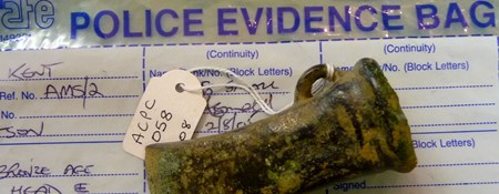 Bronze age axe head in police evidence bag