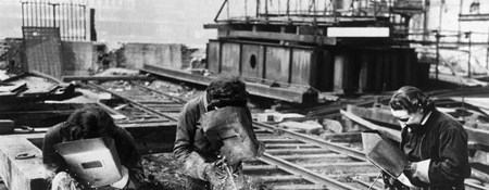 Black and white image of women welders working at Waterloo Bridge during the Second World War