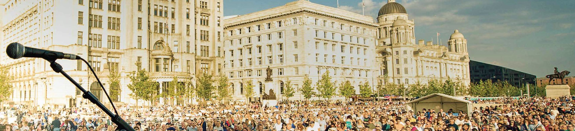 People attending open air concert in front the the Liver Building