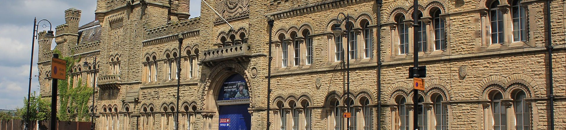 Bury, Castle Street, Drill Hall, 1868, its impressive stone–faced, gothic style frontage with crenulations was designed by Henry Styan and James Farrier, it is Grade II listed.