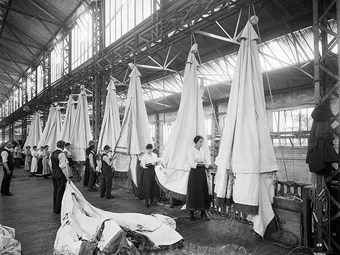 Workers packing tents at Waring & Gillow's, London