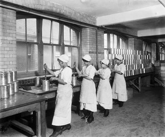 Cadby Hall food factory, Hammersmith, London, September 1918. Workers at Cadby Hall, owned by the then fledgling J. Lyons company, producing Christmas puddings for the troops