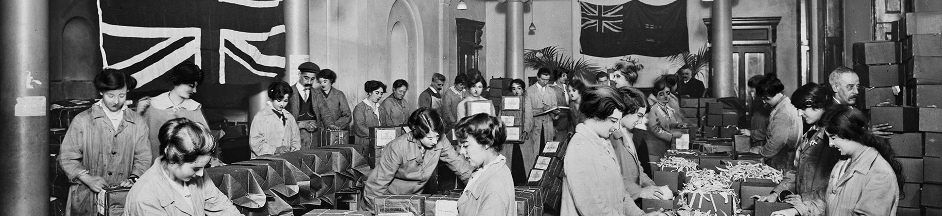 16 Regent Street, London, in a crowded room volunteers at the Australian Red Cross building pack parcels for prisoners of war