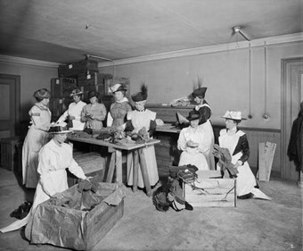 Women from the Canadian War Contingent packing socks for the troops