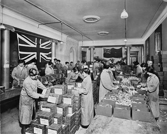 Australian Red Cross premises, 18 Regent Street, London, January 1917.  Women packing food parcels for prisoners-of-war. (BL23706-001)