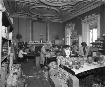 Surrey House, Marble Arch, London, 1918. Royal Flying Corps Aid Committee women are seen packing food parcels. (BL24109-002)