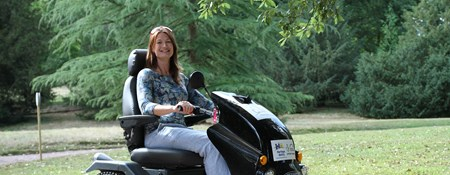 Woman in a mobility scooter