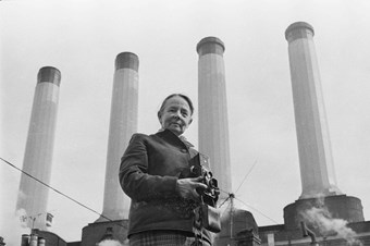 Eileen 'Dusty' Deste in front of Fulham Power Station